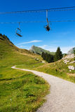 Hiking path and chairlift Stock Photo