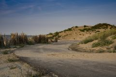 Path through the dunes, to the sea of Cadzand Bad, The Netherlands royalty free stock photography