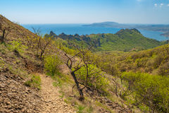 Hiking path on Karadag volcanic mountain range  in Eastern Crimea, on a Black Sea shore Royalty Free Stock Photography