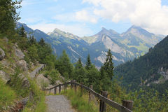 Hiking path near Isenfluh, Switzerland. View at hiking path near Isenfluh, Switzerland. The mountains of Schynige Platte at the background stock photo