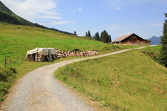 Hiking path near Muerren, Switzerland, cabin and mountains Royalty Free Stock Photo
