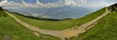 Hiking path and  from Niederhorn, view of Swiss Alps.Switzerland. View of hiking path, Lake Thun and Bernese Alps from Niederhorn, Niederhorn, Bernese Oberland Royalty Free Stock Photo
