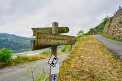 Hiking Path and Sign Post on the Rhine River Hiking Trail or `Rheinsteig`. royalty free stock photo