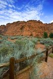Hiking Path in Snow Canyon with Rails in the Image Royalty Free Stock Photos