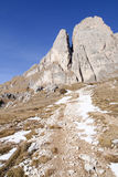 A hiking path with snow in the Dolomites Stock Images