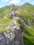 Hiking path in the summer. Hiking path on a rocky landscape in summer to Omu Peak, Bucegi Mountains, Romania Stock Photography