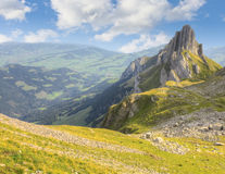 Hiking path, Switzerland. Hiking path through rocky mountainous terrain with sharp rock formations in the background, Switzerland Stock Image