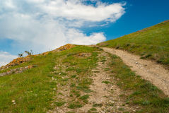 Hiking path to uplands in spring mountains Stock Image
