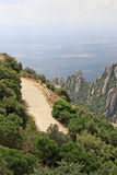 Hiking paths in the mountains near Benedictine abbey Santa Maria de Montserrat in Monistrol de Montserrat, Spain Royalty Free Stock Images