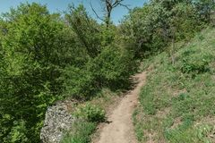 Hiking pathway- journey through roads, mystical nature. Mountain landscape- springtime mystical nature. Journey through roads and stone- hiking pathways royalty free stock photos