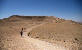 Hiking people in desert Royalty Free Stock Image