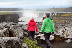 Hiking people in Iceland nature landscape Selfoss. Hiking people in Iceland nature landscape with Selfoss waterfall. Hikers walking with view of famous Icelandic Royalty Free Stock Image
