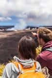 Hiking people looking at Hawaiian volcano Stock Photo
