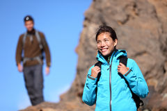 Hiking people - woman outdoors portrait. Hiking people. Hiker woman portrait outdoors in mountain scenery. Man in background Royalty Free Stock Images