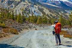 Hiking photographer taking pictures Royalty Free Stock Photo