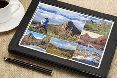 Hiking pictures on digital tablet Royalty Free Stock Photography