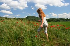 Hiking on poppies field royalty free stock photos