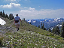 Hiking the Ridge Line. This image of the lone hiker was taken along the trail to the summit of Mt Aeneas in western MT Stock Photography