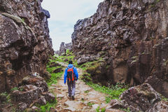 Hiking in rocky canyon, backpacker Stock Images