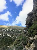 Hiking the rocky terrain of the Crypt Lake Trail, a steep ascent stock photos