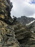 Hiking the rocky terrain of the Crypt Lake Trail, a steep ascent stock photography