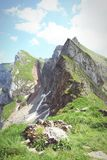 Hiking in Rofan mountain aeria in Tyrol (Austria). Retro retouch of image stock photography