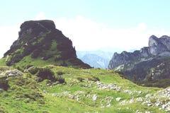 Hiking in Rofan mountain aeria in Tyrol (Austria). Retro retouch of image stock photos