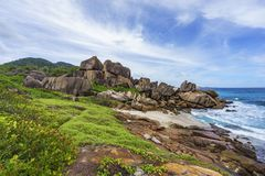 Rough and wild rocky coastline at anse songe, la digue, seychell Stock Image