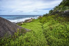 Rough and wild rocky coastline at anse songe, la digue, seychell Royalty Free Stock Photo
