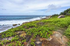 Rough and wild rocky coastline at anse songe, la digue, seychell Royalty Free Stock Images