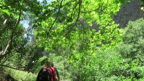 Hiking through the Samaria Gorge at Crete Greece. Trail leading through the lefka Ori mountains towards the sea.