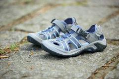 Hiking sandals outdoor on trail Stock Photo