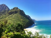 Hiking the scenic Kalalau Trail to the scenic Na Pali Coast in Kauai Hawaii Stock Image