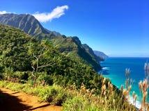 Hiking the scenic Kalalau Trail to the scenic Na Pali Coast in Kauai Hawaii Stock Photo