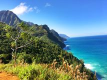 Hiking the scenic Kalalau Trail to the scenic Na Pali Coast in Kauai Hawaii Stock Images