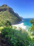 Hiking the scenic Kalalau Trail to the scenic Na Pali Coast in Kauai Hawaii. The scenic but rugged and dangerous Kalalau Trail to the scenic Na Pali Coast in Stock Images