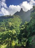 Hiking the scenic Kalalau Trail to the scenic Na Pali Coast in Kauai Hawaii Royalty Free Stock Images