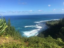 Hiking the scenic Kalalau Trail to the scenic Na Pali Coast in Kauai Hawaii Royalty Free Stock Photos
