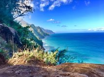 Hiking the scenic Kalalau Trail to the scenic Na Pali Coast in Kauai Hawaii Royalty Free Stock Photography