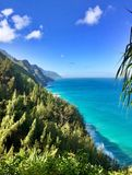 Hiking the scenic Kalalau Trail to the scenic Na Pali Coast in Kauai Hawaii Royalty Free Stock Image