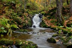 A stream with a small waterfall in Schwarzwald. Hiking through the Schwarzwald in Germany stock image