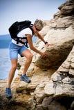 Hiking at sea Stock Images