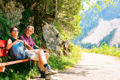 Hiking Senior Couple. Active senior couple being active outdoors in summer Royalty Free Stock Image
