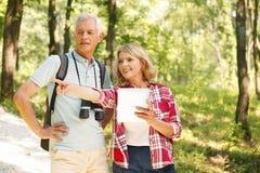 Hiking senior couple Stock Images