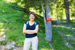 Hiking Senior Woman. Having fun outdoors in summer Stock Images