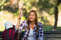 Hiking senior woman resting on bench Royalty Free Stock Photo