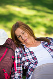 Hiking senior woman resting tired on bench Stock Images