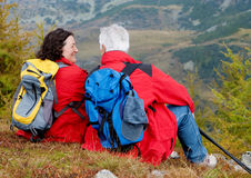 Hiking seniors 1. Cute seniorcouple hiking in an autumn mountainlandscape stock images