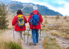Hiking seniors 10. Cute seniorcouple hiking in an autumn mountainlandscape royalty free stock photography