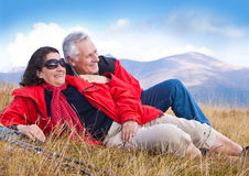 Hiking seniors 14. Cute seniorcouple hiking in an autumn mountainlandscape stock photo